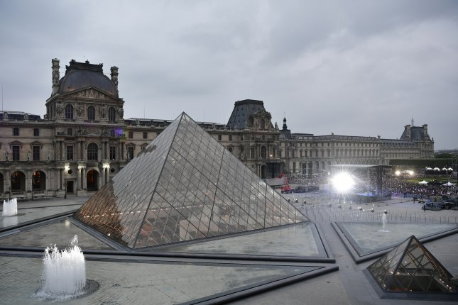 Officials at the Louvre said heavy rainfall damaged a number of paintings, and the walls and ceiling of some gallery space. File Photo by Philippe Lopez/EPA