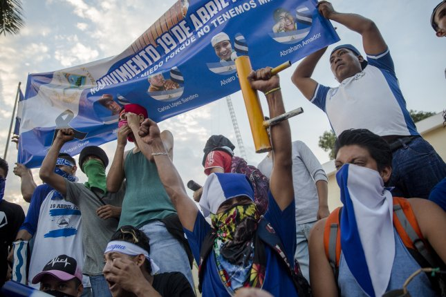 Protesters carry a banner Saturday during a demonstration against the government of Nicaraguan President Daniel Ortega, in Niquinohomo, Nicaragua. Photo by Jorge Torres/EPA-EFE