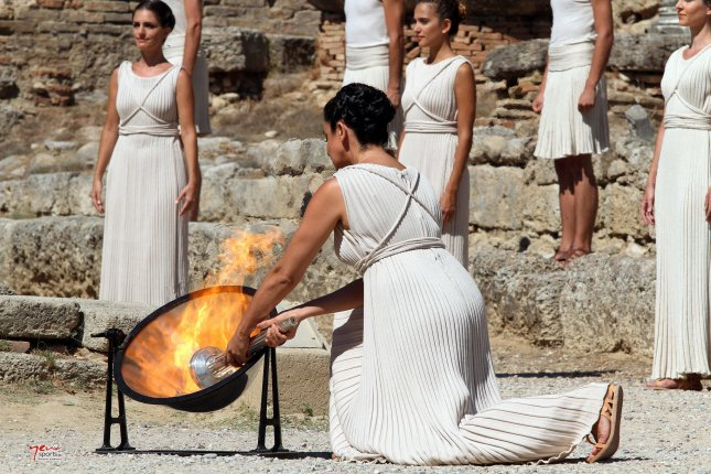 Greek actress Ino Menegaki lights the Olympic flame at a ceremony at the Temple of Hera, marking the beginning of its 123-day relay from Greece to Sochi for the 2014 Winter Olympics. (Flicker/International Olympic Committee)