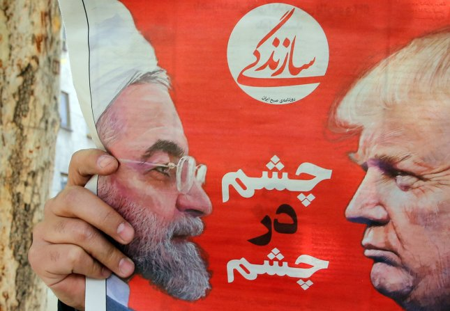Tensions between Iranian President Hassan Rouhani (L) and U.S. President Donald Trump (R) have been rising since late April when Trump revoked waiverspermitting countries to purchase Iranian oil without violating U.S. sanctions. Photo by Abedin Taherkenareh/EPA-EFE
