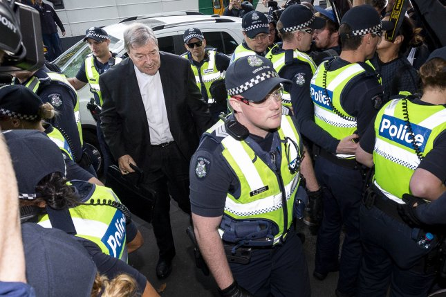 Catholic Cardinal George Pell arrives at a magistrates court in Melbourne, Australia, for trial on charges he sexually assaulted two boys during the 1990s. File Photo by Daniel Pockett/EPA-EFE