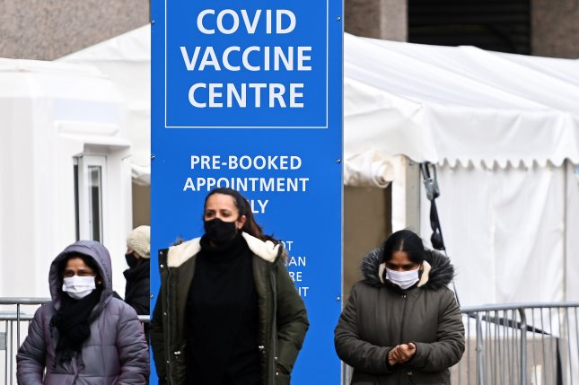 Britons are seen at a COVID-19 vaccination center in London, Britain, on February 10. File Photo by Andy Rain/EPA-EFE