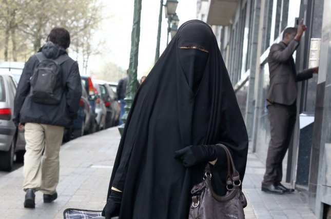 Danish Parliament voted Thursday to ban face veils worn by Muslim women, becoming the latest European country to outlaw the burqa and niqab. File photo by Julien Warnand/EPA-EFE