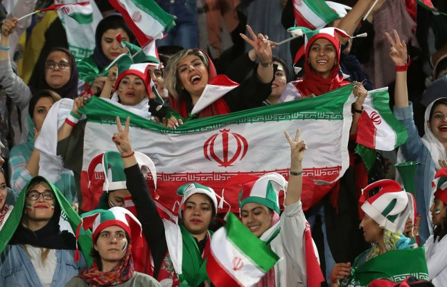 Thousands of women attempted a soccer game in Iran for the first time in 40 years on Thursday as the country's national team defeated Cambodia 14-0 in a World Cup qualifying match. Photo by Abedin Taherkenareh/EPA