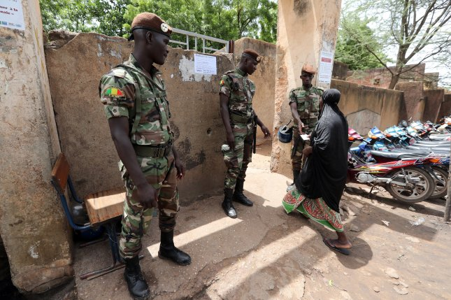 Malian soldiers stand guard at a polling station during the presidential election in Bamako, Mali, on July 29, 2018. At least 53 soldiers and one civilian were killed in a terrorist attack Friday. File Photo by Mohamed Messara/EPA-EFE