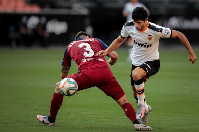 Valencia's Goncalo Guedes (R) scored the first goal of a 2-0 win against Osasuna on Sunday at Mestalla Stadium in Valencia, Spain. Photo by Biel Alino/EPA-EFE