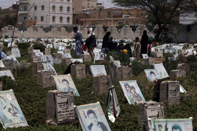 Yemenis walk among portraits on the graves of people allegedly killed in Yemen's prolonged fighting, at a cemetery in Sanaa, Yemen, Tuesday. A rebel military spokesman claimed Tuesday that rebels fired missiles from Sanaa toward defense ministry, intelligence and air base in the Saudi capital. Photo by Yahya Arhab/EPA-EFE