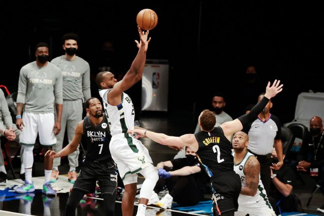 Milwaukee Bucks forward Khris Middleton (shooting) scored 19 points in each half of a win over the Brooklyn Nets in Game 6 of their Eastern Conference Semifinals series Thursday in Milwaukee. Photo by Jason Szenes/EPA-EFE