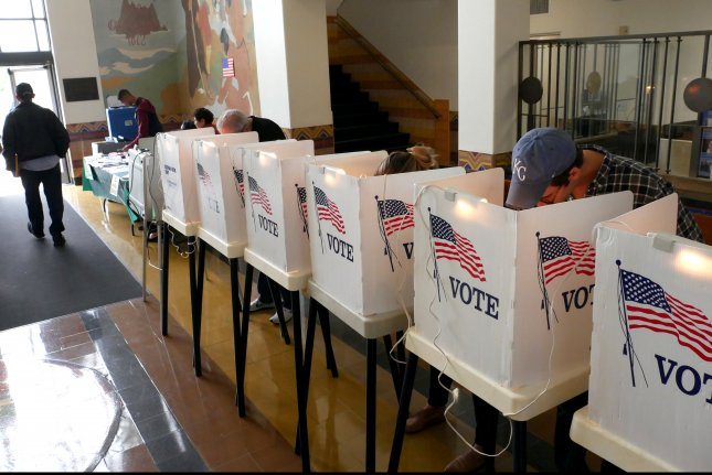 Voters mark their ballots at the Santa Monica City Hall polling station Tuesday as Californians went to the polls to decide a number of match-ups for November. California was one of eight states voting Tuesday. Photo by Mike Nelson/EPA-EFE