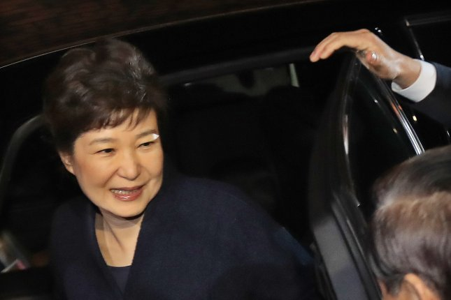 Ousted President Park Geun-hye gets out of a car in front of her private residence in southern Seoul, South Korea. She arrived Sunday from the presidential mansion, two days after judges upheld her impeachment by the parliament. Photo by Yonhap News Agency/EPA
