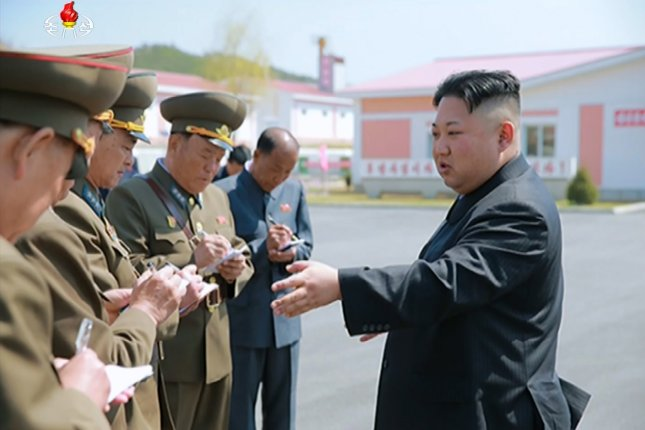 North Korean leader Kim Jong-un tours a pig farm run by a North Korean Air Force unit. North Korea's official Korean Central News Agency reported it on April 23. File Photo by Yonhap