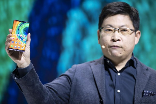 Huawei CEO Richard Yu shows the new 5G-compatible Mate 30 smartphone on Thursday. Photo by Lukas Barth-Tuttas/EPA-EFE