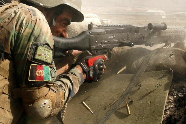 An Afghan national army soldier fires during a military maneuver at the outskirts of Kabul, Afghanistan. File Photo by Jawad Jalali/EPA-EFE