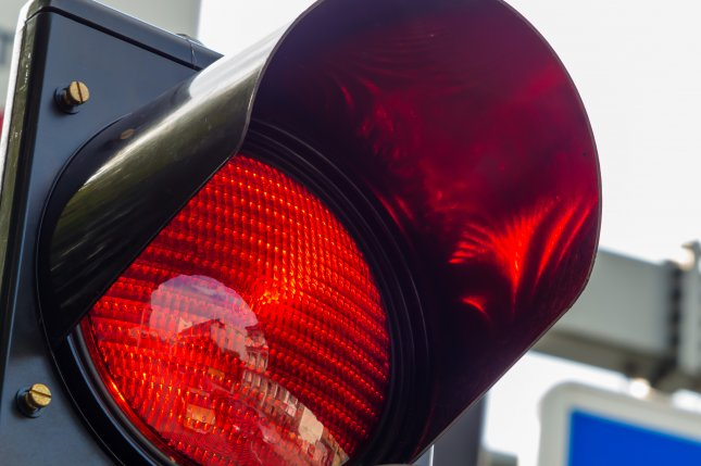 The former CEO of a red-light camera company pleaded guilty to bribery Friday. File photo by Lisa S./Shutterstock.com