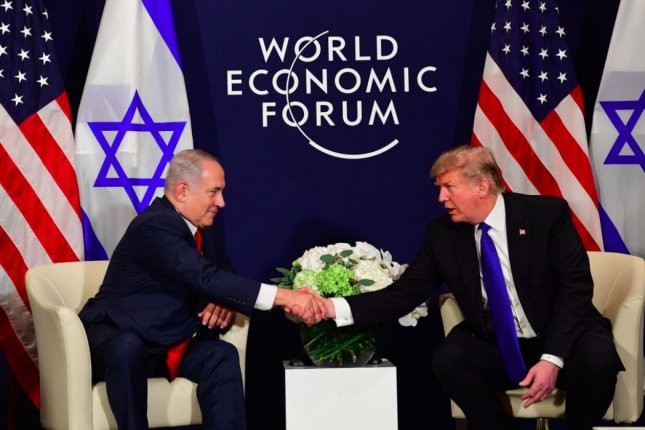 Prime Minister of Israel Benjamin Netanyahu (L) shakes hands with U.S. President Donald Trump at the World Economic Forum in Davos, Switzerland, on Thursday. Photo courtesy of PM of Israel/Twitter