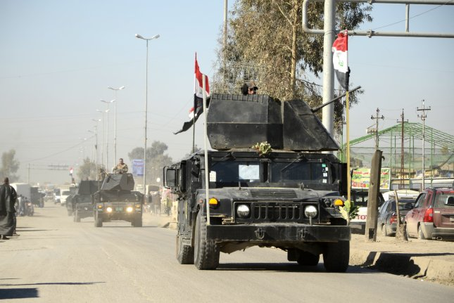 Iraqi security forces mobilize in Mosul on Sunday, the first day of the offensive to free western Mosul from the Islamic State. Iraqi forces on Wednesday moved toward the Mosul International Airport after the facility was heavily bombarded. Photo by STR/EPA