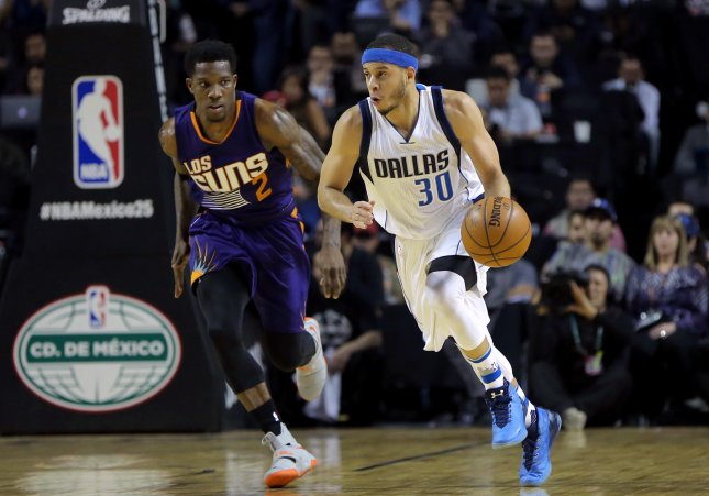 Eric Bledsoe (L) defends as Dallas Mavericks guard Seth Curry dribbles during a recent game. Bledsoe has reportedly been traded from the Phoenix Suns to the Milwaukee Bucks. Photo by Jose Mendez/EPI