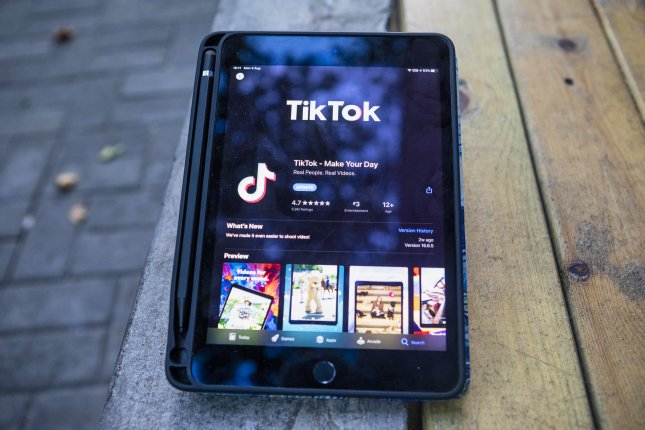 China threatened sanctions Saturday in response to the Trump administration announcing that it would begin banning Chinese social apps TikTok and WeChat on Sunday.  File Photo by Alex Plavevski/EPA-EFE