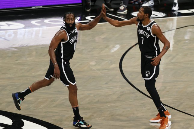 Brooklyn Nets guard James Harden (L) has averaged 24.9 points and 11.4 assists in 18 games with the Nets. File Photo by Jason Szenes/EPA-EFE