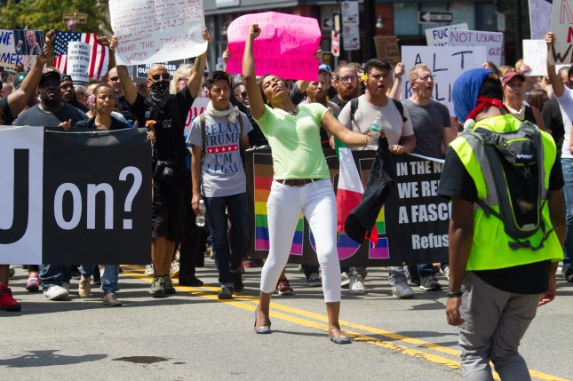 A Free Speech Rally in Boston ended early on Saturday afternoon, as at least 10,000 counter-protesters marched to the site on the Boston Common and outnumbered rally attendees. Photo by Matthew Healey/EPA