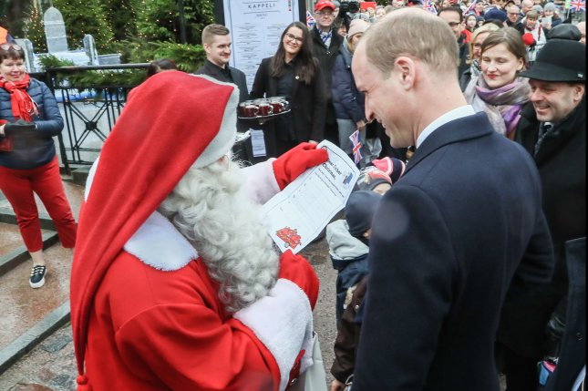 Prince William presents Santa with letter from son George