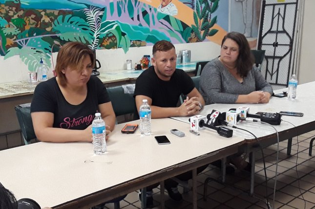 From left: Digna from El Salvador and Mario from Honduras, accompanied by legal coordinator Taylor Levy, speak to reporters Monday about their concerns for how long it has taken them to regain custody of their children. Photo by Edwin Delgado/UPI