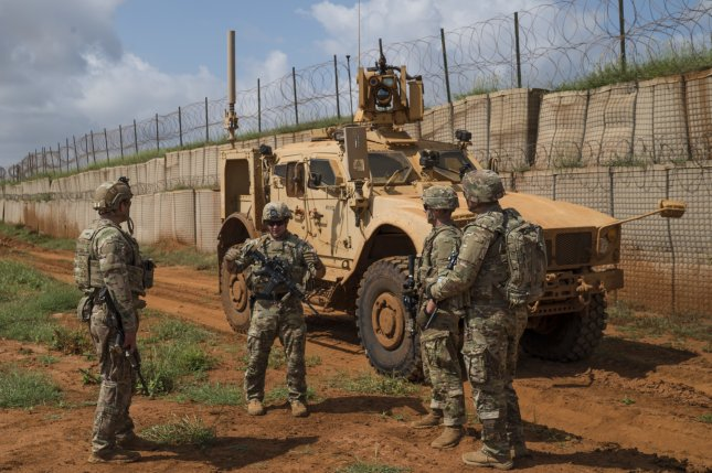 U.S. Army soldiers discuss operations during a security patrol stop in Somalia on December 3, 2019. File Photo by Tech. Sgt. Nick Kibbey/U.S. Air Force