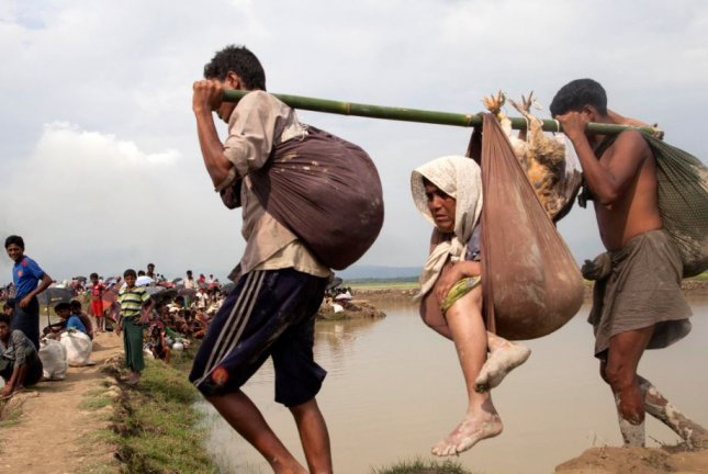 Rohingya Muslims enter Bangladesh as they flee violence in Myanmar. File Photo by stringer/EPA-EFE