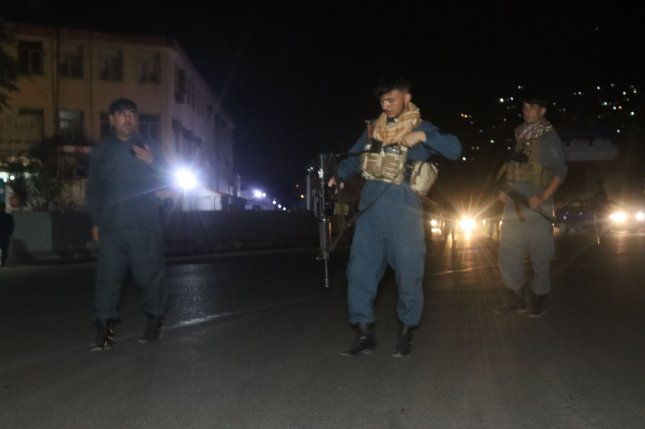 Afghan security officials stand guard on a road leading to the scene of a huge explosion in Kabul, Afghanistan, on Tuesday. Photo by Jawed Kargar/EPA-EFE