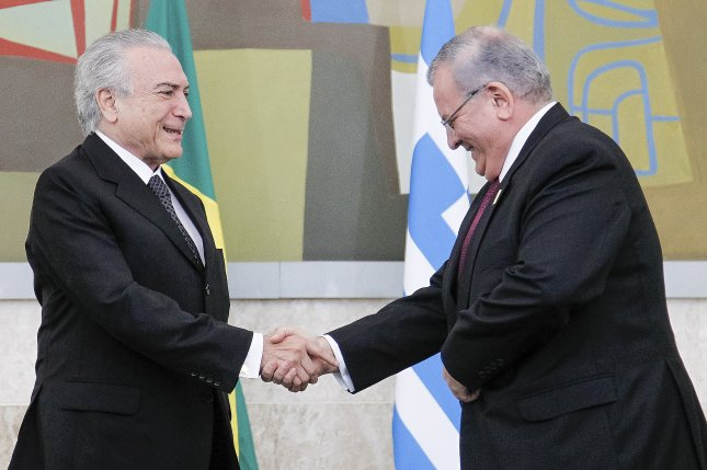 The wife of Greece's ambassador to Brazil Kyriakos Amiridis (R) was detained by police along with a Brazilian police officer and a third man believed to be the officer's cousin as suspects after the ambassador's body was found in a burnt-out car beneath an overpass. Police said they will recommend charges of homicide against Kyriakos' wife, Francoise Oliveira, the policeman, Sergio Gomes Moreira, and his cousin Eduardo Melo after the three confessed to conspiring to murder the ambassador in what police are treating as a crime of passion. File Photo by Beto Barata/Presidency of Brazil/European Pressphoto Agency