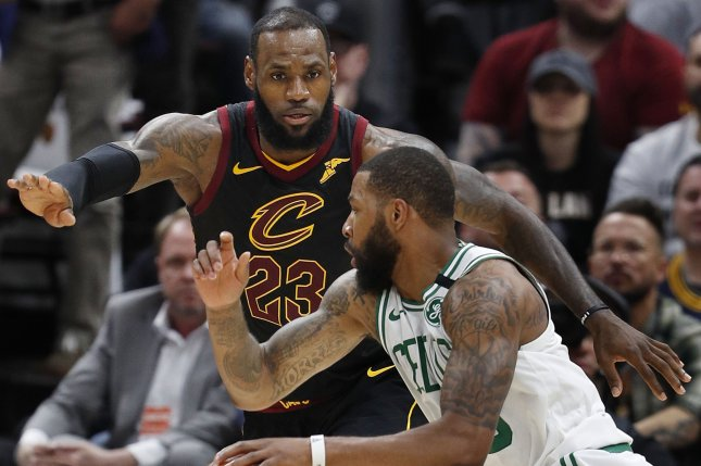 56f9b2874 Cleveland Cavaliers forward LeBron James (L) defends against Marcus Morris  (R) of the Boston Celtics during the second half of Game 6 of the Eastern  ...