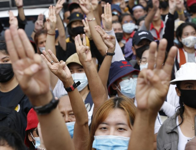 Thai anti-government protesters flash the three-finger salute during their march to the Government House in Bangkok, Thailand, on Wednesday. On Thursday, the government issued a decree to disband the protests. Photo by Narong Sangnak/EPA-EFE