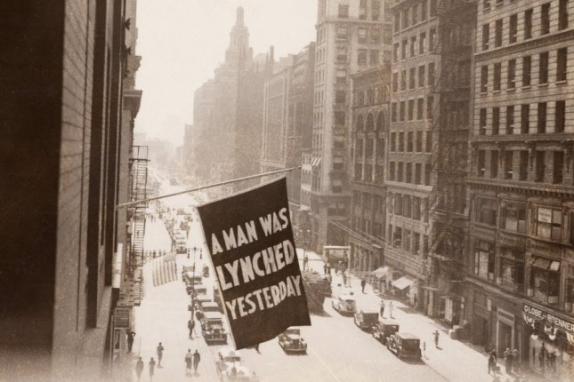 Flag announcing A man was lynched yesterday is flown from the window of the NAACP headquarters on 69 Fifth Ave., New York City in 1936. Photo by Everett Historical/Shutterstock