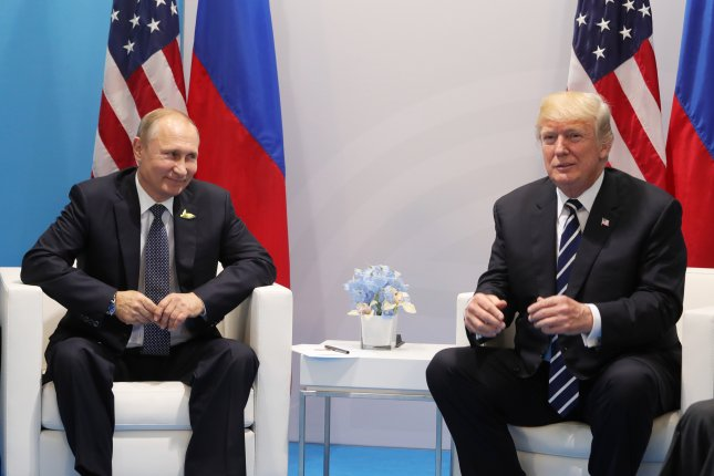 Russian President Vladimir Putin (L) and U.S. President Donald J. Trump (R) meet on the sidelines of the G20 summit in Hamburg, Germany, on July 7. Putin said U.S. sanctions on Russia destroy international relations. Photo by Michael Klimentyev/Kremlin pool/EPA