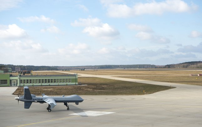 A remotely piloted MQ-9 Reaper taxis toward the runway shortly after a ribbon-cutting ceremony at Miroslawiec Air Base, Poland, March 1, 2019. Photo by Senior Airman Preston Cherry/U.S. Air Force