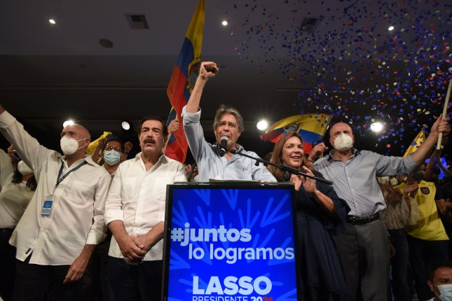 President-elect Guillermo Lasso (C) delivers statements, in Quito, Ecuador, on Sunday. Lasso has been declared the winner in this Sunday's ballot in Ecuador over his rival Andres Arauz. Photo by Santiago Fernandez/EPA-EFE Fernandez