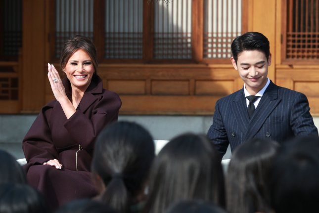 Melania Trump (L) spends time with Shinee singer Minho at an event in Seoul, South Korea, on Tuesday. File Photo by Yonhap News Agency/EPA