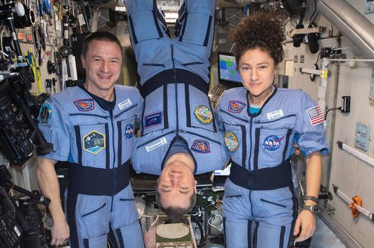 NASA flight engineers Andrew Morgan (L) and Jessica Meir (R) flank Expedition 62 Commander Oleg Skripochka of Roscosmos for a portrait in the weightless environment of the International Space Station. Photo courtesy of NASA