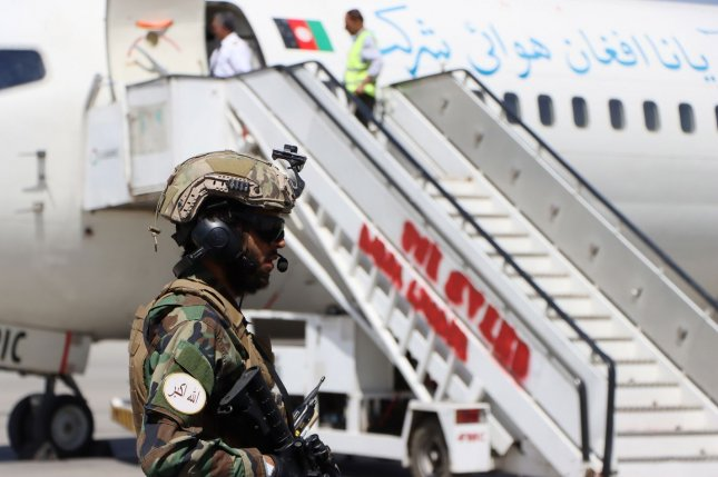 Afghan security officials stand guard after flight operations resumed at Hamid Karzai International Airport in Kabul, Afghanistan, on Sunday. Photo by EPA-EFE