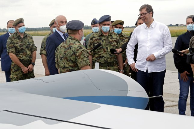 Serbian President Aleksandar Vucic stands near new military drones purchased from China on Saturday. Beijing said Tuesday it has entered an arms trade treaty. Photo by Koca Sulejmanovic/EPA-EFE