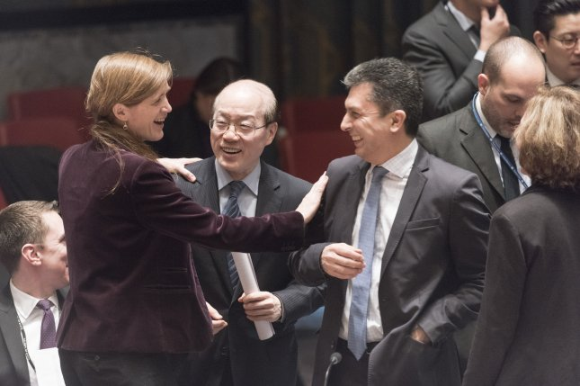 United States UN representative Samantha Power (L), speaks with Liu Jieyi of China (C), and Movses Abelian, Director of the UN's Security Council Affairs Division on March 2, 2016 at the United Nations in New York. The Security Council unanimously adopted resolution 2270(2016), imposing additional sanctions on North Korea in response to the country's continued pursuit of a nuclear weapons and ballistic missile program. Photo by Mark Garten/UN/UPI
