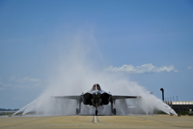 """Pratt & Whitney has landed a $1.03 billion F135 jet engine deal for the F-35 Lighting II fighter. Pictured Lt. Col. Christine Mau navigates her F-35A through the """"bird bath"""" after returning from her first flight on Eglin Air Force Base, Fla., May 5, 2015. Photo by Staff Sgt. Marleah Robertson/U.S. Air Force/UPI"""