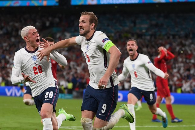 Harry Kane (C) of England celebrates after scoring the game-winning goal against Denmark during the UEFA Euro 2020 semifinals Wednesday at Wembley Stadium in London. Photo by Laurence Griffiths/EPA-EFE