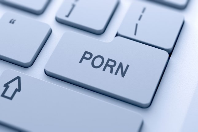 A computer keyboard with a porn key. Photo by dencg/Shutterstock.com