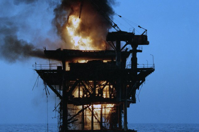 An Iranian command and control platform is set afire October 19, 1987, after being shelled by four U.S. Navy destroyers. The shelling was a response to a recent Iranian missile attack on a reflagged Kuwaiti super tanker. File Photo courtesy of U.S. Navy