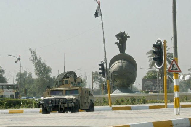 U.S. forces stand guard at Al-Nisoor Square in Baghdad, Iraq, on September 24, 2007, after 14 Iraqis died after an attack involving U.S. security firm Blackwater. File Photo by Mohammed Jalil/UPI