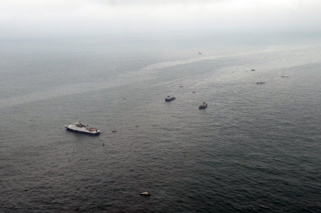 A handout photo made available by Russian Ministry of Emergencies shows rescue boats searching in Black Sea on Sunday in the waters off Sochi for wreckage and casualties from a government-owned Tu-154 jetliner that crashed en route to Syria. Nearly 100 people were on board the plane, including dozens of musicians from the Alexandrov Song and Dance Ensemble, the Russian military's official choir. Photo courtesy Russian Ministry of Emergencies/European Pressphoto Agency