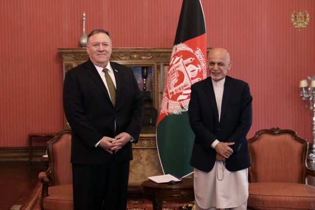 U.S. Secretary of State Mike Pompeo (L) and Afghan President Ashraf Ghani meet in Kabul, Afghanistan, on Monday. Photo courtesy of Sediq Sediqqi/Afghan government