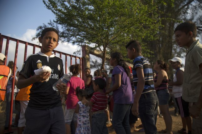 Central American migrants wait in line for food during their stay at the Matias Romero town, in Oaxaca state, Mexico, on April 4. The migrants were part of a caravan making its way to the United States. File Photo by Luis Villalobos/EPA-EFE