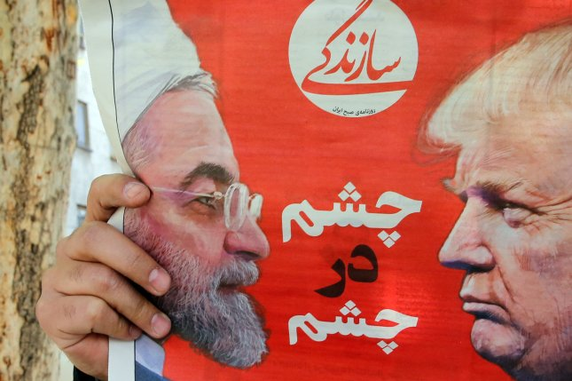 An Iranian newspaper depicts Iranian President Hassan Rouhani and U.S. President Donald Trump on its April 8 front page. File Photo by Abedin Taherkenareh/EPA-EFE
